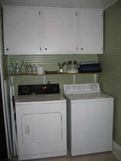 Shelf on the wall below the cabinets and above the washer/drier for even more storage