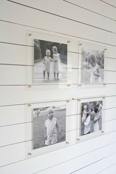 black and white family photos in acrylic frames ecause lucite frames are transparent, the wall behind them has the power to completely transform the look of whatever they display. Black and white family photos that might look bold and modern against a dark gray wall, appear beachy and nostalgic when hung in a shiplap mudroom on Crisp Interiors.