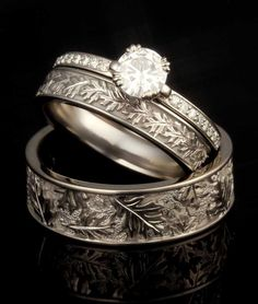 This wedding set features his and hers Oak Leaf Wedding Bands and a Carved Leaf Pave Engagement Ring