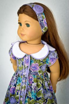 Purple floral button up dress by AnnasGirls on Etsy. Made with the Bluebelle Dress pattern, found at http://www.pixiefaire.com/products/bluebelle-dress-18-doll-clothes. #pixiefaire #bluebelledress
