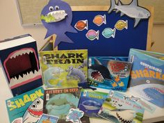 """""""Our final week for the winter session is finally here! This makes me so happy since that means that spring in coming. It also makes me sad because I have enjoyed the children and their parents so much. This week we ended our session with the theme of Sharks. We read The Three Little Fish and the Big Bad Shark by Ken Geist, Shark in the Park by Phil Roxbee, I'm a Shark by Bob Shea, Sharks by Valerie Weber, Gilbert in the Deep by Jane Clark, Shark vs. Train by Chris Barton and Surprising… Three Little, Little Fish, Chris Barton, Children's Choice, Traditional Tales, City Library, Finals Week, Kindergarten Classroom, Literacy Activities"""