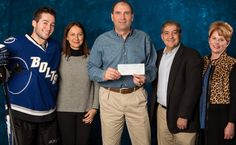 Tyler Johnson (left) joined Tampa Bay Lightning owner Jeff Vinik and his wife Penny (right) to present Paul and Suzanne Avery with a check for $50,000, which was donated to Friedreich's Ataxia Research Alliance (FARA)..