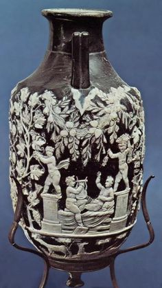 Imperial Roman blue glass amphora, in cameo glass technique, found on the Street of Tombs outside the Herculaneum Gate, Pompeii.