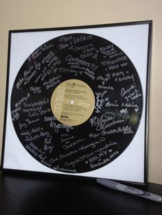 Custom Vinyl Record Wedding Guestbook Alternative w Personalized Center Label. $45.00, via Etsy.