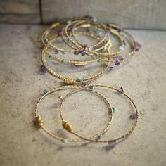As if further evidence was needed that fashion and music go hand-in-hand, along comes this set of upcycled bangles from Restrung Jewelry. Lovingly crafted with worn gold-tone guitar strings, twisted wire and semi-precious stones, this set of upbeat bracelets (six amethyst and six green turquoise) is ready to rock your next arm party.