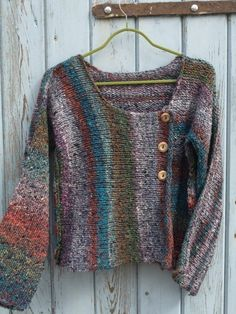 Noro Silk & Wool Cardigan (no paattern). Note front is knit side-to-side and back is knit up and down.  This might work with that Cascade Souk I've been hanging on to.