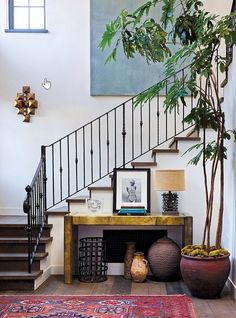 Railing/stair decor. spacious entry, wrought iron railing, red rug, wide plank wood floors
