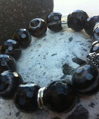 Black Swan Bracelet made of sterling silver and agate. Brand name LU.