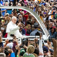 Pope Francis waves from the popemobile on the Benjamin Franklin Parkway moments before the Papal Mass Sunday September 27 2015. #PVatPope Photo by- @thom_carroll