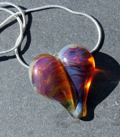Light amber purple heart necklace glass