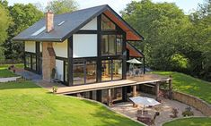 "Elfin Hollow (in Tunbridge Wells) uses ""insulated panels, under floor heating, solar panels to heat water, triple glazing, an air circulating system with heat exchange, and a rain harvester."""
