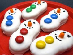 Ingredients: 1 pack Nutter Butter cookies 1 bag Vanilla Almond Bark 1 bag M&Ms 1 container orange tic=tacs 1 Black Decorator Icing (the gel writing type works best) Melt the Almond Bark for 90 …