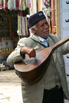 Strolling singer in the Market in Masouleh, Iran