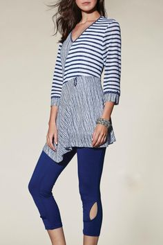 """Beautiful blue and white striped tunic with loads of detail.  3/4 length sleeves with cutout and silver button detail at the sleeve.  V-neck and fully lined.  Cute fabric tab with button at the waistline.  Great top for any occasion.  Looks great with white capris or slacks.  Model is 5'8"""" and is wearing a size Small. Blue White Tunic by Zoe. Clothing - Tops - Tunics Iowa"""