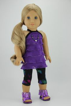 This listing is for a three piece outfit. It includes a top, leggings and necklace. The ruffled halter top is made with purple ruffled knit