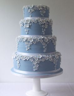 Blue Blossoms Pretty blue tiers edged with white falling blossoms and tiers serves up to 200 Elegant Wedding Cakes, Beautiful Wedding Cakes, Gorgeous Cakes, Wedding Cake Designs, Pretty Cakes, Amazing Cakes, Quinceanera Cakes, Fantasy Cake, Icing Flowers