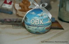 Outer Banks ornament makes a great wedding favor. ALC Wedding Photography http://www.outerbanksweddingassoc.org/membersearch/memberpage.html?MID=2058=Photographer=16 #favors #outerbanks #outerbankswedding #ornament