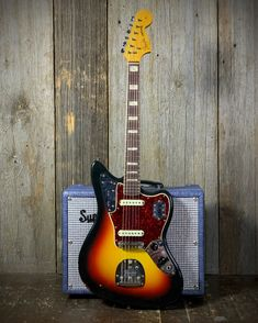 Here's a nice one from '66. This Fender Jaguar appears to have all its original hardware, and sports cool block inlays. Stop by our showroom and plug it in, or give it a spin with our 360 photos at elderly.com.