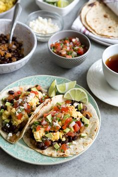 Black Bean Breakfast Tacos - BREAKFAST TACOS INGREDIENTS: 1 tablespoon vegetable or canola oil, divided 1/2 medium yellow onion (about 3/4 cup), diced One 15-ounce can black beans, drained and rinsed 3 tablespoons water 1 teaspoon taco seasoning 4 large Eggland's Best eggs salt and pepper, to taste 6 taco-sized flour tortillas pico de gallo, or salsa of choice 1 medium avocado, pitted, diced crumbled queso fresco, as needed
