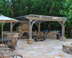 Outdoor patio and fireplace with arbor.  Nice layout.  We like the lamps.  Has kitchen, dining, and living area.  Could add a hot tub to this area.