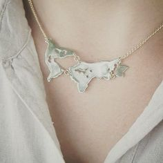 Keep your wanderlust close to your heart - wear the world. Fair Trade and Handmade world map necklace