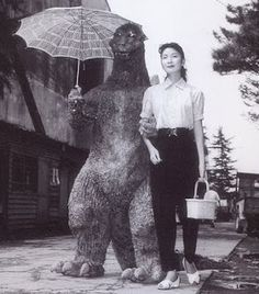 Godzilla and his first leading lady, Momoko Kochi,  got along much better off screen, as you can see in  this behind the scenes shot from GODZILLA, KING  OF THE MONSTERS