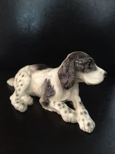 Vintage Wien Keramos Porcelain Springer Spaniel  This engaging figurine was designed in Wien/Vienna Austria by Rudolf Chocholka (1888-1958), who was well known for his magnificent animal sculptures.  At 7″ long, it is substantial, and it would easily stand alone as a focal piece. CLICK NOW TO ORDER!!