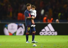 Lionel Messi of Barcelona carries his son Thiago following the UEFA Champions League Final between Juventus and FC Barcelona at Olympiastadion on June 6, 2015 in Berlin, Germany.