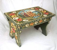 Narrowboat cabin stool painted in traditional roses and castles