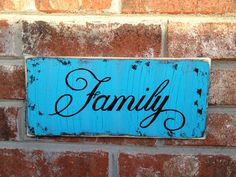 Rustic Shabby Chic Turquoise and Black Crackled Finish Family Sign Home Decor Hanger. $15.00, via Etsy.