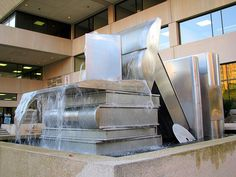 In front of the new downtown Chattanooga Library is this fountain, which is water streaming down large metal books. They probably wouldn't like it if you treated their actual books this way. Cool Books, I Love Books, Books To Read, Idea Books, Monuments, Statues, Beautiful Library, Book Sculpture, World Of Books