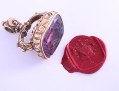 gold mounted intaglio amethyst fob seal and wax impression of the Carey family