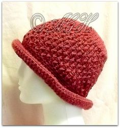 A pretty little rolled-brim beanie hat, with a textured stitching.