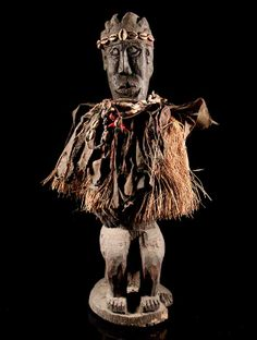 Africa | Fetish figure from the Ewe people of Togo | Wood, textiles, natural fiber, cowrie shells