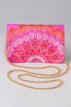 Azizah Embroidered Mini Clutch---pair this with the Pensacola Printed Maxi Dress for an extra touch of boldness and  fun!