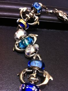 This is so cool using the #Trollbeads Dolphins Pendant.