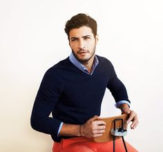 How to wear a sweater: choose a fitted v-neck style which contours the body without cling, keep the collar wings tucked in, roll up the sleeves below the elbow showing slight shirt cuff.