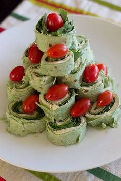 A Christmas tree pita pinwheel appetizer that is an adorable hit for any holiday party.