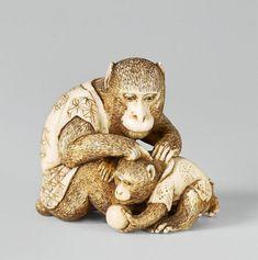 An ivory netsuke of two monkeys. Late 19th century