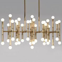 Globes of light pop from a bamboo-like frame, giving the Jonathan Adler Meurice Rectangular Chandelier retro distinction with Hollywood Regency quality.
