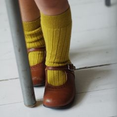 Bright spring green knee-highs and golden brown leather Mary Janes, tasteful combination.. (Winnie)