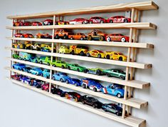 I like the design I seen at toys r us where they displayed the toy metal cars I GW likes. Similar to this but the cars are stored facing forward. And color organized of course !