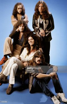 Photo of David COVERDALE and Tommy BOLIN and Jon LORD and Ian PAICE and Glenn HUGHES and DEEP PURPLE; L-R (back): Ian Paice, David Coverdale, (front): Glenn Hughes, Tommy Bolin, Jon Lord - posed, studio, group shot,