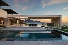 In order to deal with the steep pitch of the land, the home was created in a layered design, with guests entering through a central level of the home and private spaces being hidden below, nestled in the side of the mountain itself.