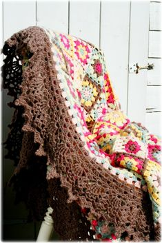 Evening Sun Blanket - a gorgeous edging makes a simple afghan look elegant