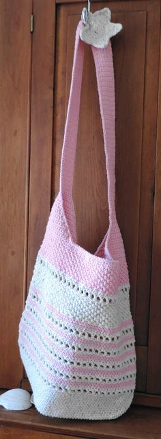 "Hand crocheted - shoulder or cross body Beach Bag in cotton candy pink cotton embellished with signature A Bit of Beach hand crocheted flower at the shoulder.     Yarn is 100% cotton.      The bag measures 16"" wide at the base with a 14"" drop. Total length of bag from top to bottom measures 34"". ..."
