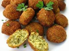 Falafel Day is a day dedicating to the celebration of one of Israel's favorite foods, falafel. A street food which is an Israeli obsession, falafel is a Greek Recipes, Veggie Recipes, Vegetarian Recipes, Cooking Recipes, Baked Falafel, Falafels, Tofu, Chickpea Patties, Gastronomia