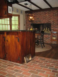 Kitchen Brick Tile Floor And Brick Tile Fireplace Wall. The Fireplace Is  The Lancaster Running