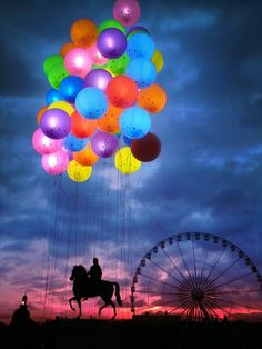 Man riding a horse with balloons overhead.  (6/2/2013) Art: Rainbows, A Favorite Thing of Mine (CTS)