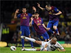 Andres Iniesta of FC Barcelona (R) Lionel Messi of FC Barcelona (C) duels for the ball with Pepe of Real Madrid CF during the La Liga match between FC Barcelona and Real Madrid at Camp Nou on April 21, 2012 in Barcelona, Spain. sportspictures